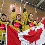 Canadian fans celebrate after Cindy Klassen won the gold and Kristina Groves won the silver during the women's 1500 meter speedskating at Oval Lingotto during the 2006 Winter Olympics in Turin, Italy, Wednesday, Feb. 22, 2006. (AP Photo/Koji Sasahara)